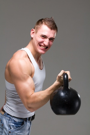 one caucasian man exercising weight training workout fitness in studio isolated on gray background photo