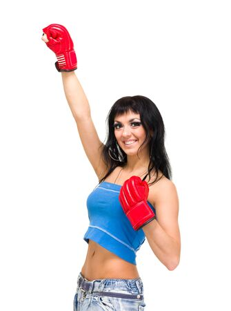 Young beautiful woman with boxing gloves at workout isolated on white photo