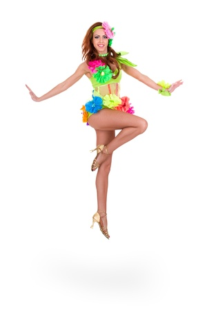 beautiful carnival dancer woman jumping against isolated white background photo