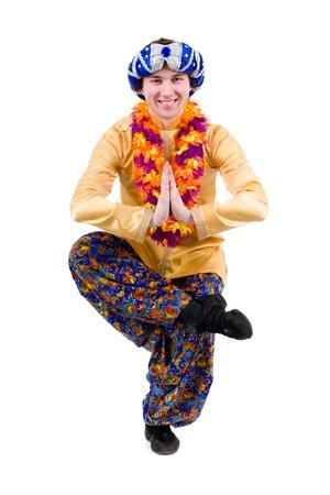 qameez: man doing yoga exercise in pose of namaste  Isolated on white background in full length  Stock Photo