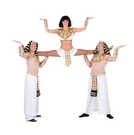 acrobatic dance team wearing a egyptian costume doing splits against isolated white background photo