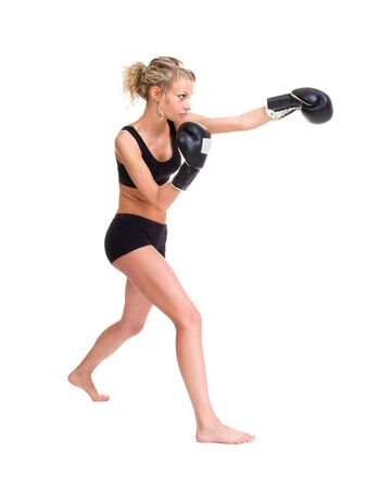 female boxer: Young beautiful woman with boxing gloves at workout   Isolated on white background in full length  Stock Photo