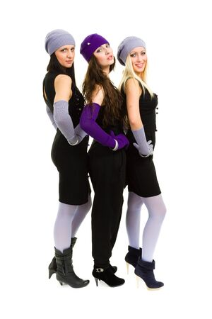 portrait of a young three women in white knit wool hat and mittens  Isolated on white background in full body  photo