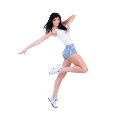 haciendo ejercicio: Fitness mujer joven haciendo ejercicio aislado sobre fondo blanco en longitud completa Foto de archivo