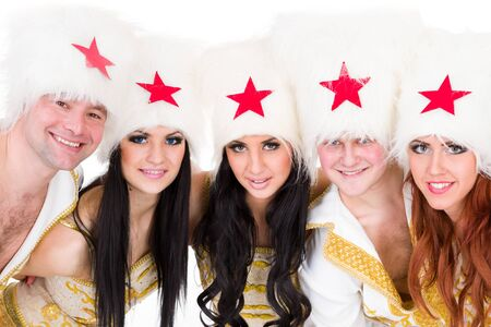papakha: smiling dancer team wearing a folk ukrainian cossack  costumes dancing   Isolated on white background in full length