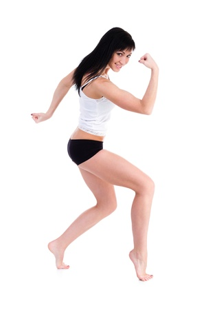 Young fitness woman doing exercise  Isolated on white background in full length  photo