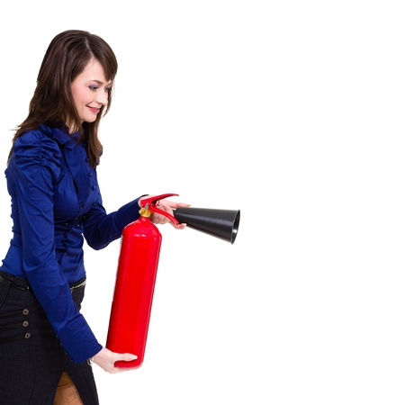 beautiful young businesswoman, using a fire extinguisher isolated on white photo