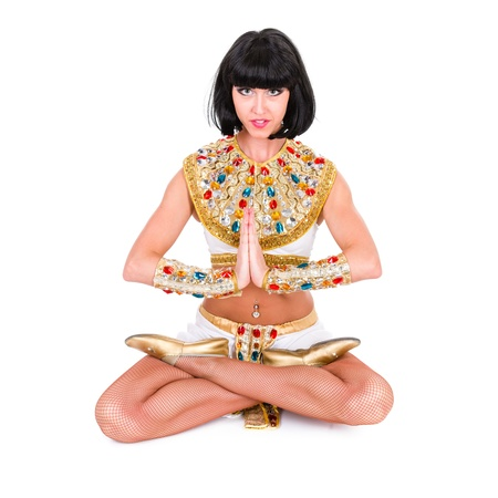 Yoga woman wearing a egyptian costume  Isolated on white background in full length  photo
