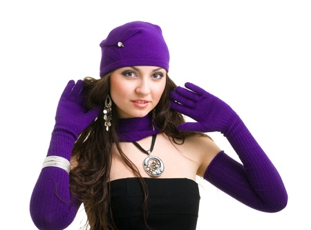 portrait of a young woman in knit wool hat and mittens  Isolated on white background photo