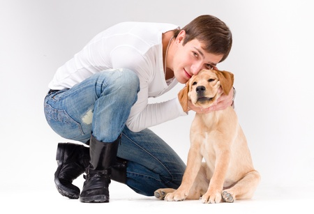 handsome man with dog over gray background photo