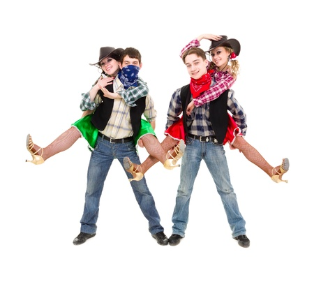 cabaret dancer team dressed in cowboy costumes dancing   Isolated on white background in full length  photo