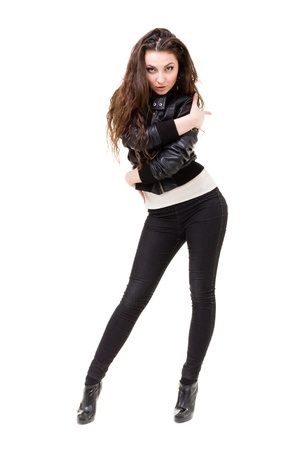 young woman rock chick in a black leather jacket and jeans full length studio portrait isolated on white photo