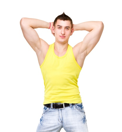 Fashion portrait of the young beautiful man in yellow t-shirt posing over isolated white background photo