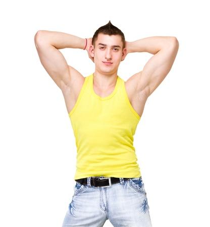 muscle shirt: Forme el retrato del hombre hermoso joven en camiseta amarilla posando sobre fondo blanco aisladas Foto de archivo