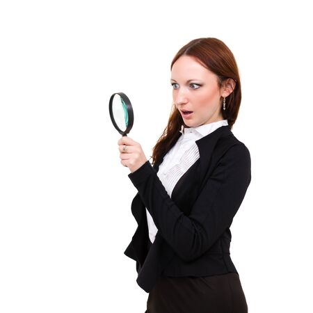 Surprised young woman with magnifying glass isolated on white background photo
