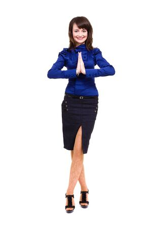Businesswoman with hands in prayer studio portrait standing full length isolated on white background Stock Photo - 18713707