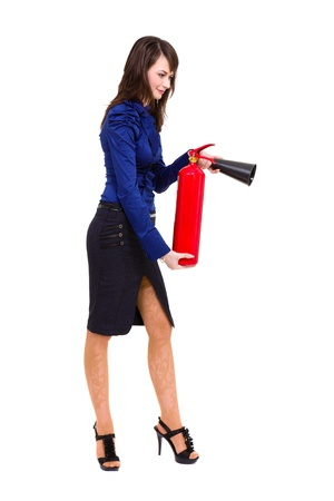 beautiful young businesswoman, using a fire extinguisher  standing full length isolated on white background photo