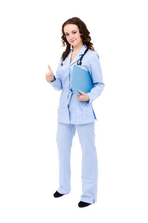 Full length of female doctor with thumbs up gesture against white background photo