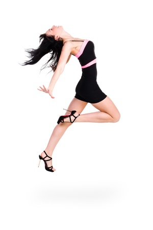 Cute elegant woman little black dress jumping,  full length studio portrait isolated on white photo