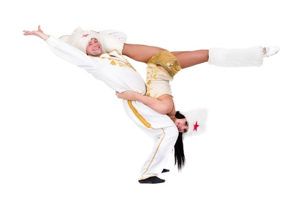 acrobatic dance couple doing splits against isolated white background photo