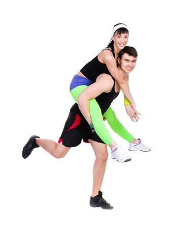 young fitness couple in the studio  isolated on white background  fitness gym concept photo