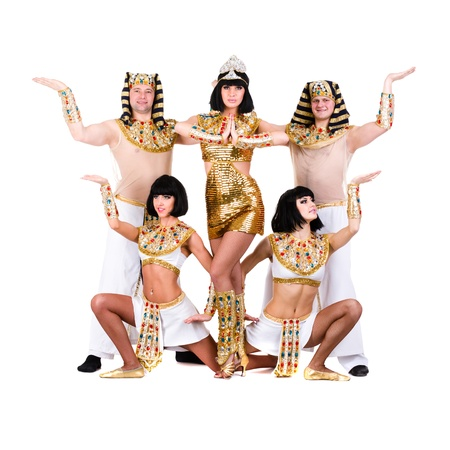 dance team dressed in Egyptian costumes posing   Isolated on white background in full length Stock Photo - 18859889