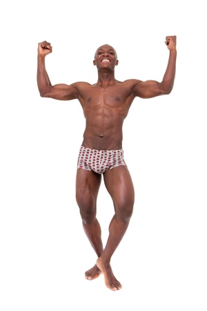 Healthy muscular man is happy with his body   Isolated on white background in full length  photo