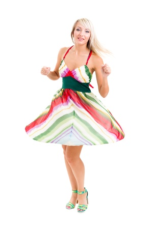 Full length of  sensual woman wearing fashion dress dancing against isolated white background photo