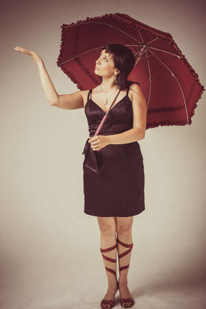 Beautiful young woman with red umbrella  Retro Portrait  Vintage Styled  photo