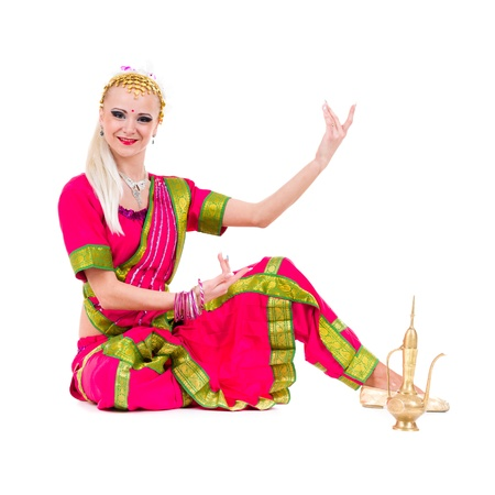 full length portrait of indian woman dancing in studio   Isolated on white background  photo