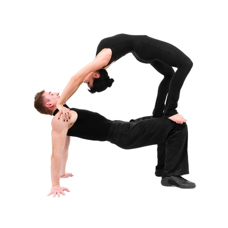 Two young modern acrobats, sports couple isolated on white background in full length  photo