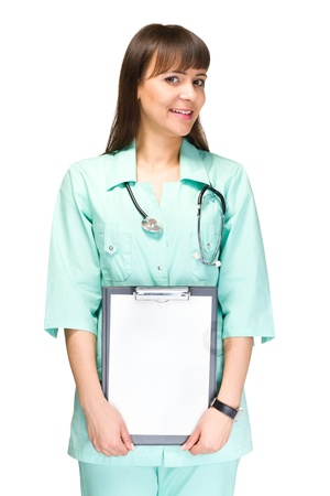 Young woman doctor or nurse showing empty blank clipboard sign with copy space for text  photo