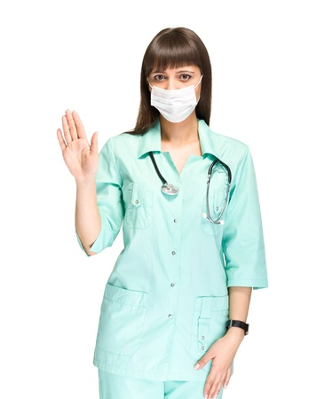 Young medical doctor or nurse making stop sign,  wearing a mask,  making stop sign, isolated on white background  photo