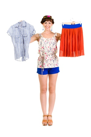 Full body portrait of  woman trying new clothing, isolated over white background photo