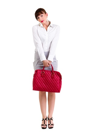 Full body portrait of business woman with red handbag, isolated over white background photo
