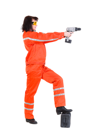 Young builder woman with a drill. Isolated over white background photo