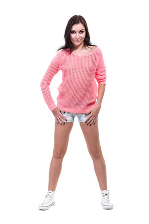 Young sexy woman in jeans shorts , isolated on white background in full length  photo