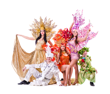 dancer team wearing carnival costumes dancing against isolated white background photo