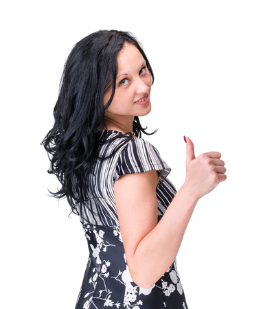 Happy woman with thumbs up - isolated over a white background photo