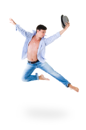 hip hop dancer jumping over isolated white background photo
