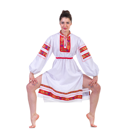 beautiful dancing girl in ukrainian polish national traditional costume clothes happy smile, full length portrait isolated over white background photo