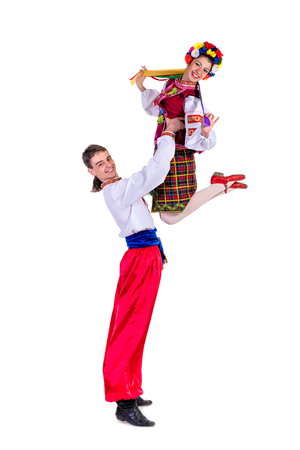 beautiful dancing couple in ukrainian polish national traditional costume clothes happy smile, full length portrait isolated over white background photo