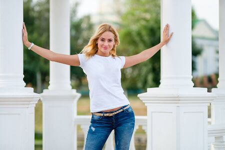 ladies: Summer girl portrait. Caucasian blonde woman smiling happy on sunny summer or spring day outside in park.