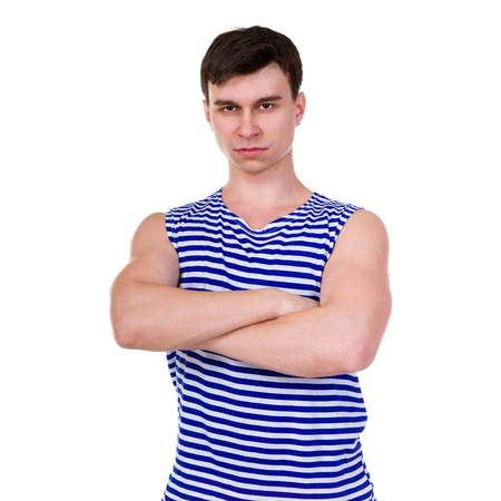 striped vest: Young man in a striped vest T-shirt isolated on white background