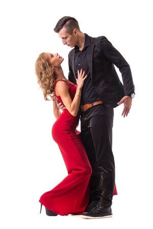 romantic man: Full length of young couple dancing against isolated white background