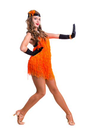 Retro dancer woman showing some movements against isolated white background Stock Photo