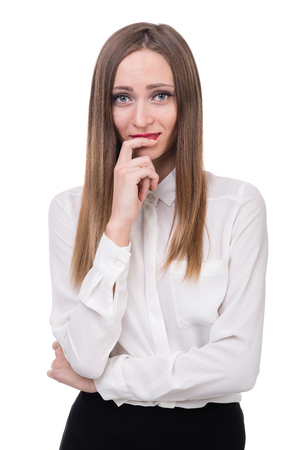 business skeptical: young woman looks skeptical, isolated on white studio shot
