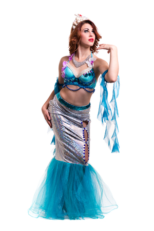 undine: Carnival dancer woman dressed as a mermaid posing, isolated on white background in full length.