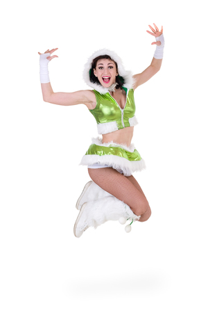 irish christmas: Friendly woman dressed like a gnome jumping. Isolated on white background in full length.