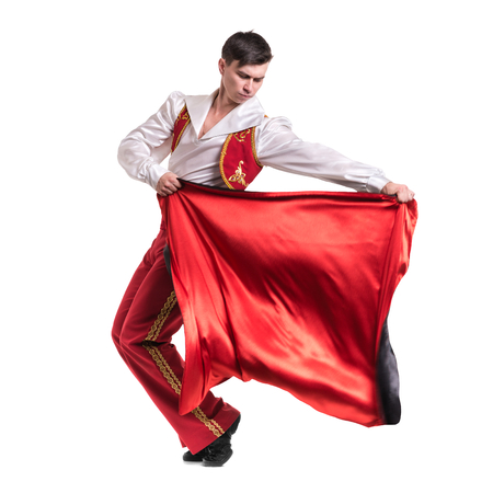 toreador: Dancing man wearing a toreador costume. Isolated on white background in full length. Stock Photo